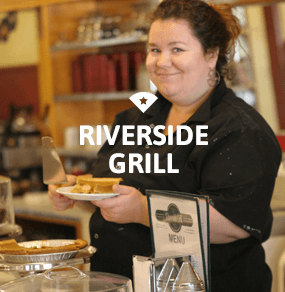 Woman serving pie at Riverside Grill