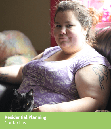 Smiling woman in her own residence